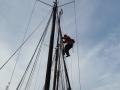 John climbs to the top mizzen mast.