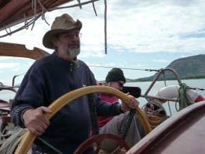 Chris at the helm of the schooner Trinovante.