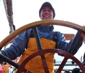Michelle at the helm of the schooner Trinovante