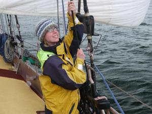 Fiona hoists the jib on Trinovante.