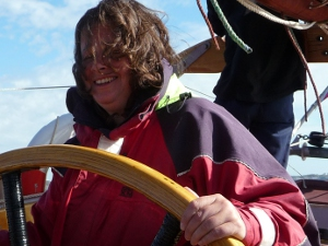 Theresa steering a schooner.