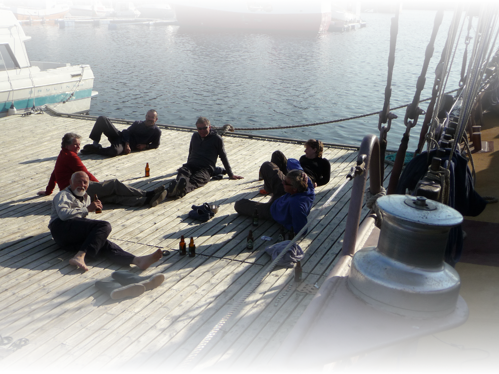 The crew of the schooner Trinovante stop for a beer after a hard days sailing.