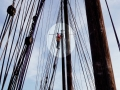 Just a speck at the mast head.
