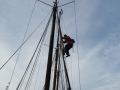 John climbs to the top mizzen mast.