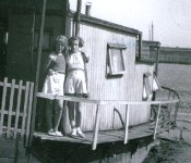 Two girls on a houseboat at Old Leigh