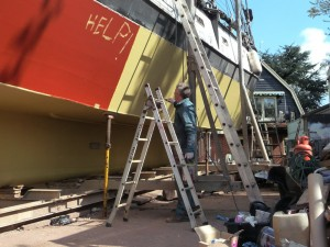 Howard painting our schooner again and again.