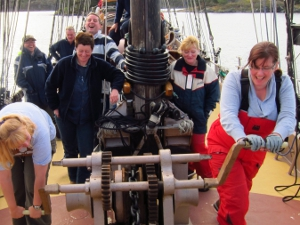 Working the anchor winch on a schooner.