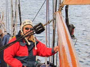 Lucy hoists the jib on a schooner.