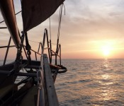 Sunset from a schooner bowsprit.