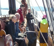 On the deck of a schooner sailing ion light winds.